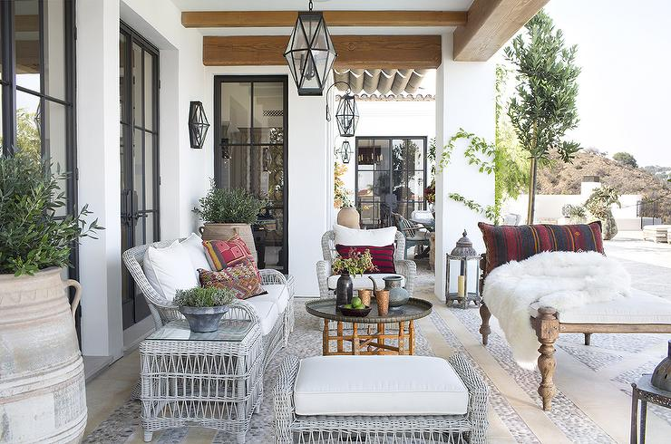 Mediterranean Style Covered Patio With Lanterns