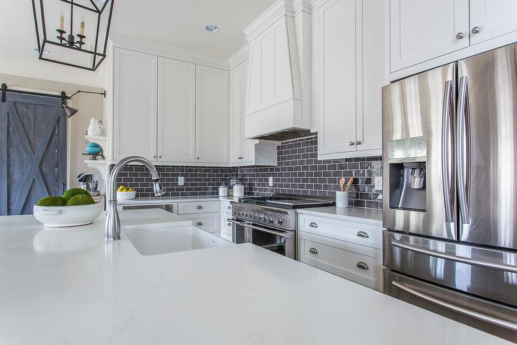 white kitchen cabinets dark backsplash gray brick kitchen backsplash tiles transitional 28729