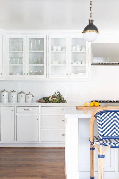 white porcelain herringbone kitchen backsplash transitional