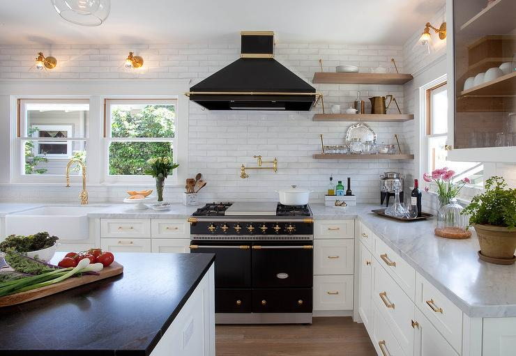 White kitchen with black window moldings contemporary - White kitchen brick tiles ...
