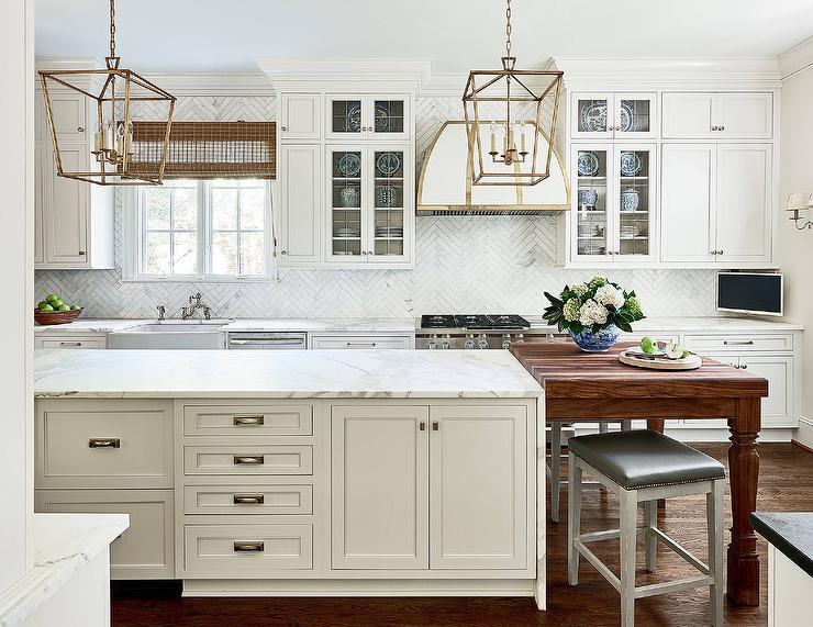 cream kitchen island with honed white marble countertop