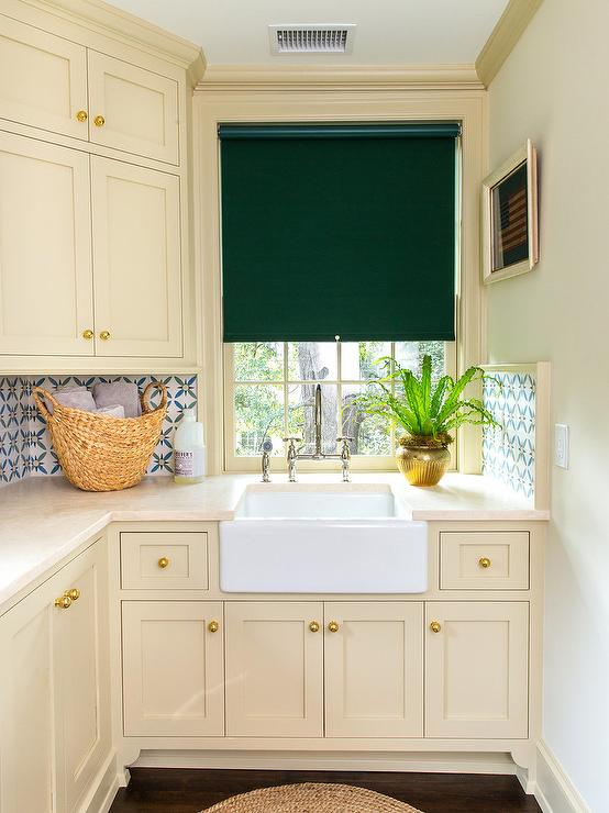 Cream Laundry Room Cabinets With Ivory Countertops