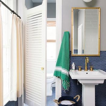 Water Closet With Louvered Door