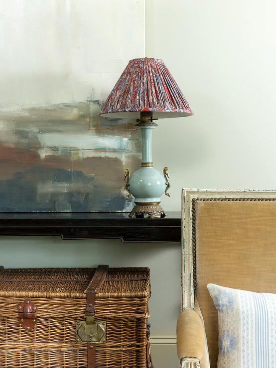 French Themed Living Room Features A Black Console Table With A Robin Egg  Blue Lamp And Pleated Multi Colored, Red Lamp Shade.