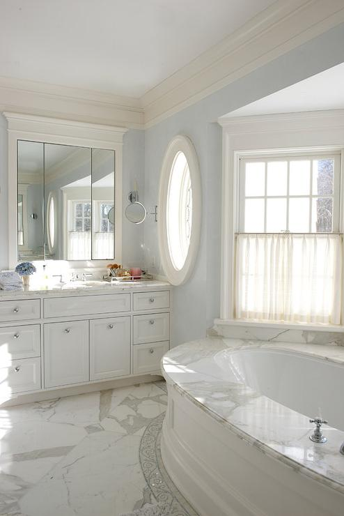 Oval Wainscoted Bathtub With Marble Deck Transitional