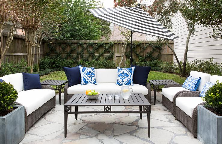 Gray Wicker Outdoor Sofa With Black And White Striped Umbrella