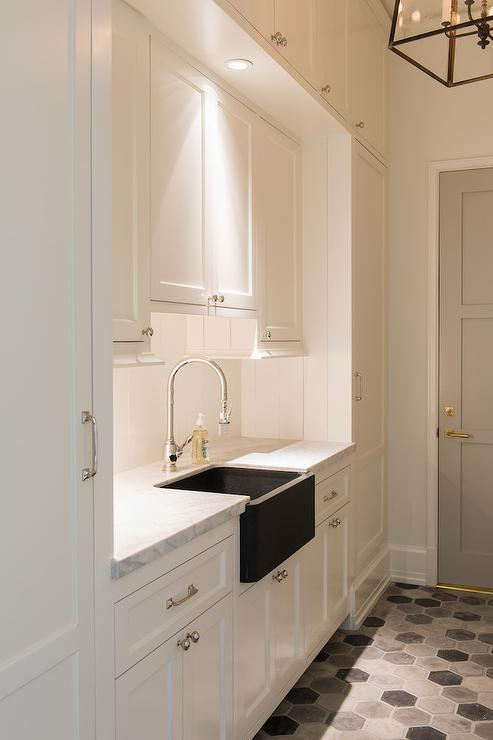 White Galley Laundry Room With Dove Gray Door