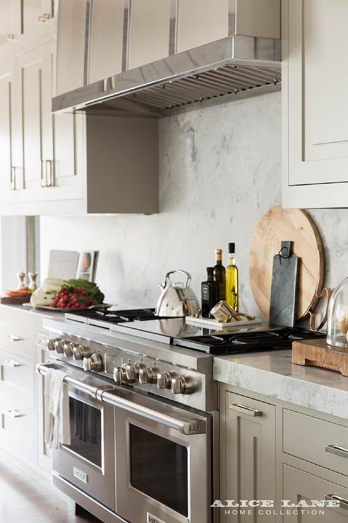 Light Grey Kitchen Cabinets With Marble Slab Backsplash