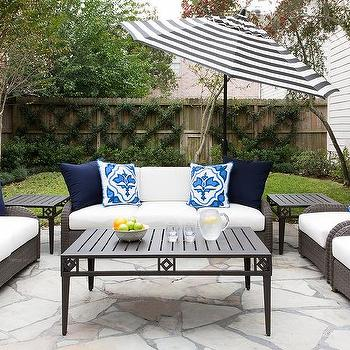 Nice Gray Wicker Outdoor Sofa With Black And White Striped Umbrella