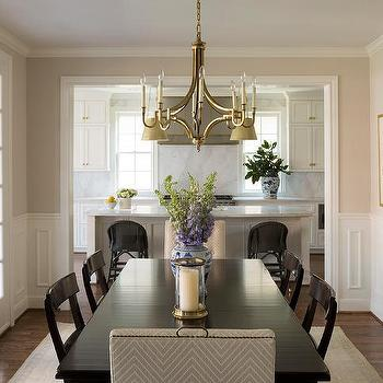 Ebony Dining Table And Chairs With Gold Chandelier