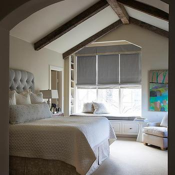 White Bedroom With Dark Wood Beam Ceiling Transitional