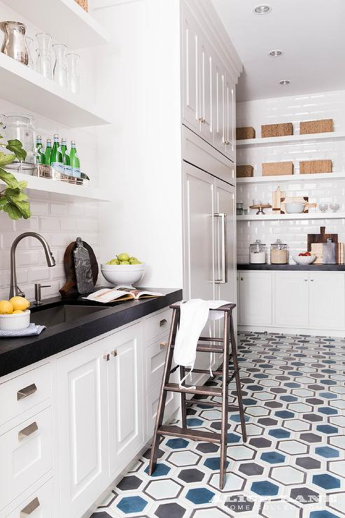 White Kitchen Pantry With Blue And Gray Hex Tiles Transitional