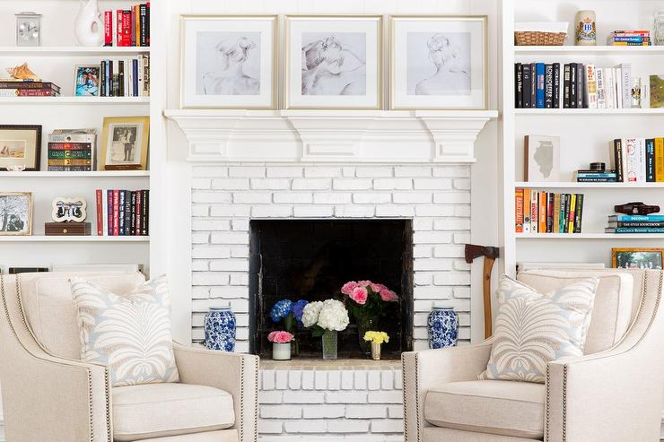 Tan Chairs In Front Of White Brick Fireplace