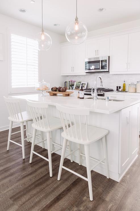 All White Kitchen With Dark Wood Floors
