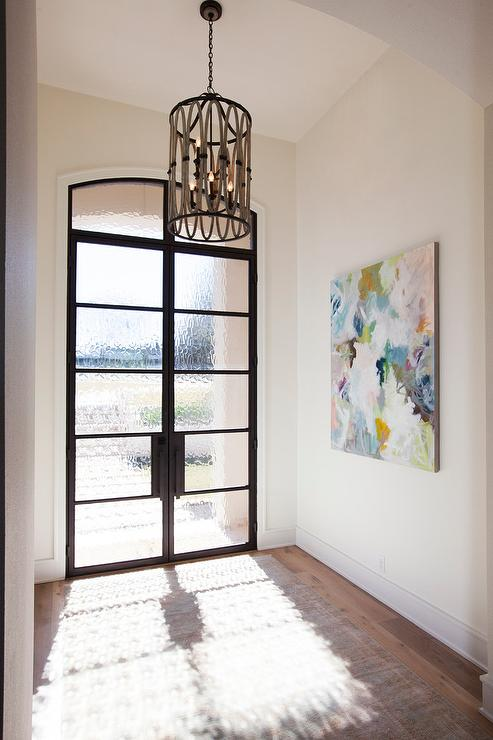 Glass Foyer Doors : Long foyer with rustic wood ceiling beams and gothic