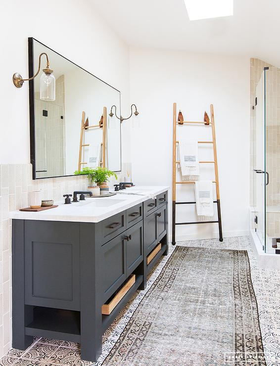 Dark Gray Dual Bath Vanity With Brass And Glass Sconces - Dark bronze bathroom faucets