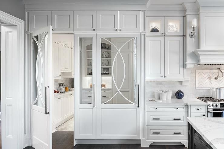 Hidden pantry behind mirrored cabinet door transitional for Hidden pantry doors