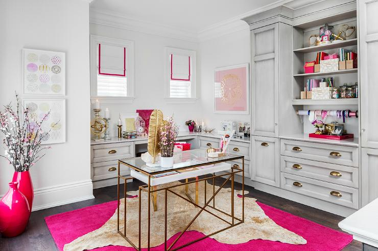 Gold Cowhide Rug Layered Over Hot Pink Rug Contemporary