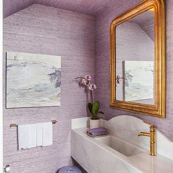 French powder room with gold beaded mirror and french sink for Purple and gold bathroom ideas