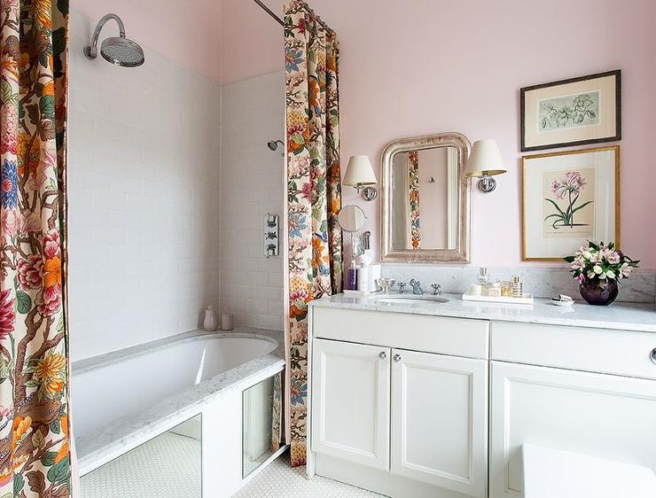 Mirror Clad Bathtub With Two Shower Curtains