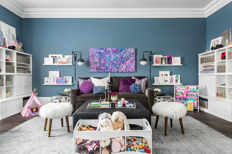 Charming Girlu0027s Playroom Features A Purple And Blue Abstract Art Piece  Mounted To A Blue Wall Between Oil Rubbed Bronze Globe Swing Arm Sconces  Flanked By ...