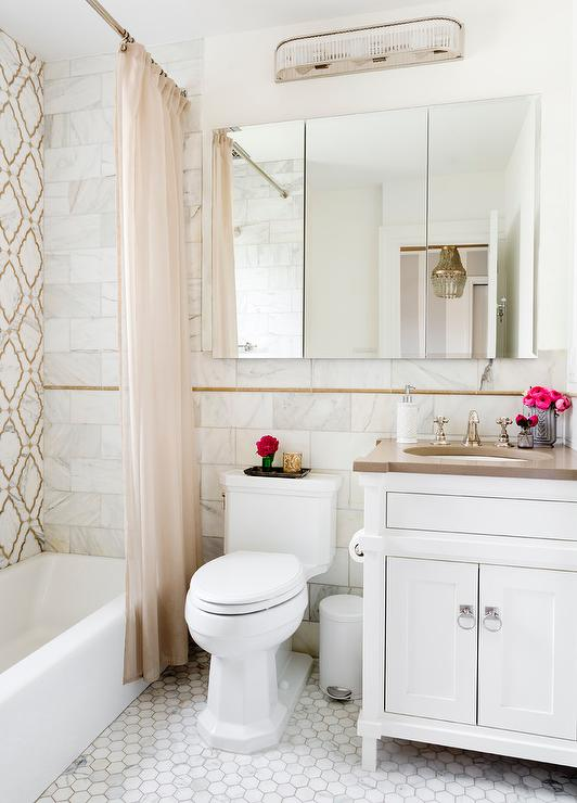 White And Brown Master Bathroom With Gold Accents
