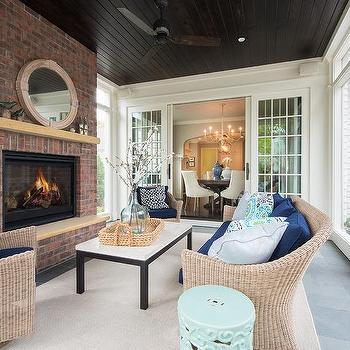 sunroom with fireplace. Sunroom with Dark Stained Plank Ceiling Black Fireplace Design Ideas