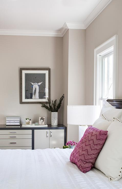 Superieur Restful Bedroom Boasts A Dark Stained Headboad Positioned Against A Cream  Colored Wall And Dressed In White Bedding Accented With A Fuchsia Chevron  Pillow ...