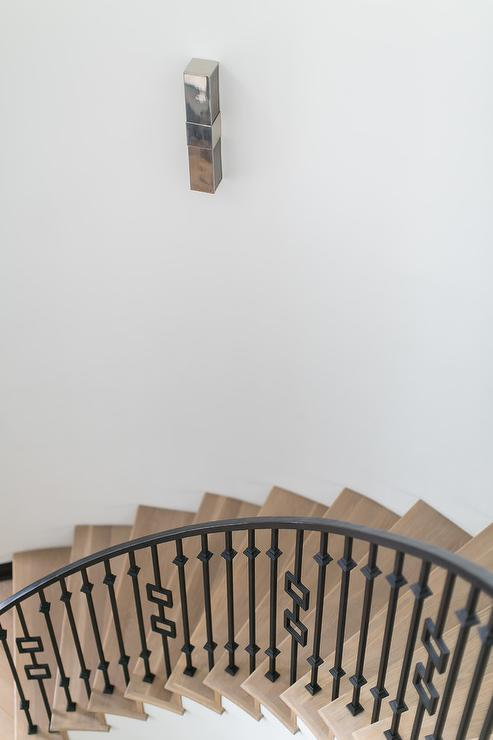 Curved Staircase With Iron Banister Transitional