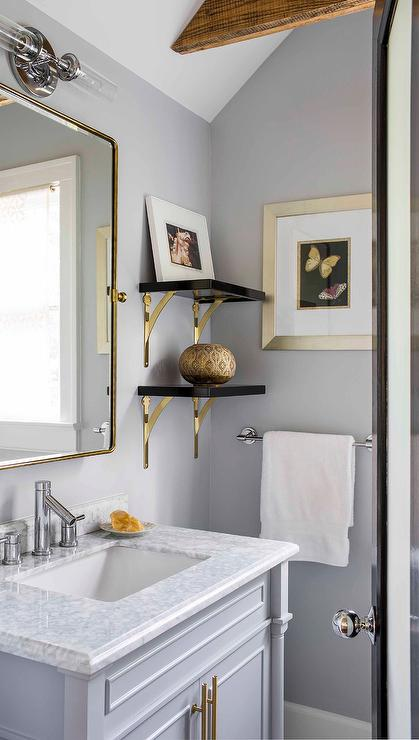 Black Shelves With Brass Brackets