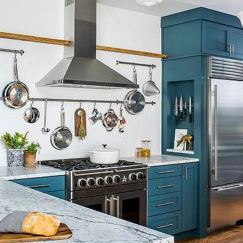 Captivating Blue Kitchen Cabinets With Carrera Marble Countertops