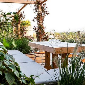 Beautiful Rooftop Deck Dining Table And Metal Chairs