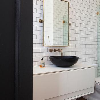 gold tone pivot mirror with black bowl sink