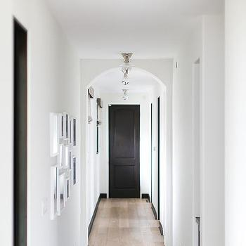 white hallway walls with black trim design ideaslong hall with arched doorways view full size long white and black hallway