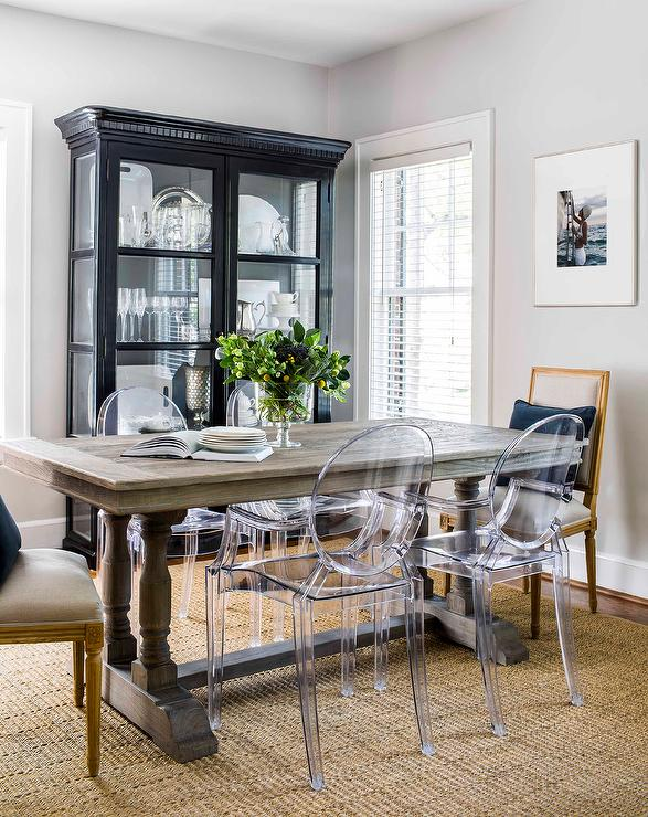Small Living Room Boasts A Ghost Dining Chairs Placed On A Seagrass Rug In  Front Of A Restoration Hardware Willems Rectangular Dining Table Also  Seating ...