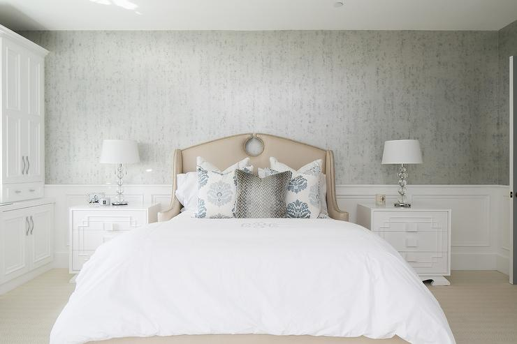 Lay Back And Relax In This Restful Gray And Beige Bedroom Furnished With A Beige Wingback Keyhole Headboard Accenting A Beige Bed Dressed In White Bedding