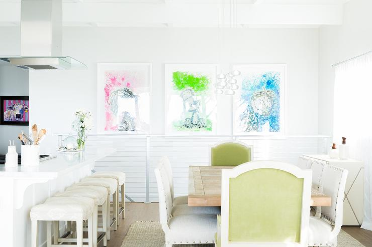 A White Dining Room Isnt Afraid To Display Pop Of Colors When Choosing Abstract Blue Green And Pink Charlie Brown Wall Art