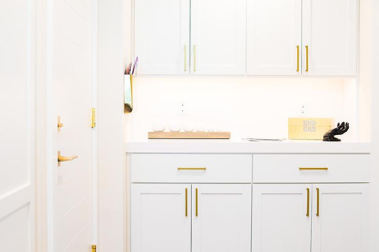 White Mudroom Cabinets With Long Brass Pulls Transitional