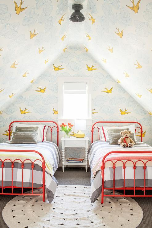 Contemporary Shared Attic Kidsu0027 Bedroom Boasts A White Round Rug Placed  Beneath Two Red Twin Metal Beds Dressed In Gray Gingham Bedding Accented  With Gray ...