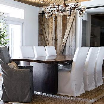 Live Edge Dining Table With Gray Slipcovered Chairs