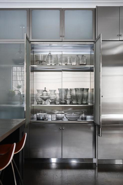 frosted glass china cabinet doors open to stainless steel shelves and are fixed above stainless steel cabinets under frosted glass overhead cabinets and - Kitchen Steel Cabinets