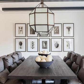 Gray Dining Room With Black Wood Ceiling Beams