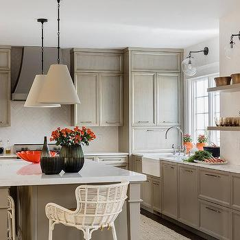 Gray Kitchen with Thin White Herringbone Backsplash Tiles & Glass And Brass Acorn Pendants Design Ideas