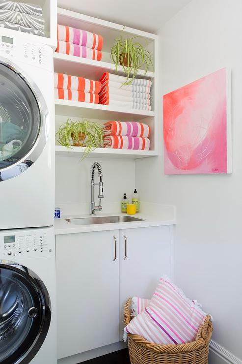 white laundry room with pink and orange accents - contemporary