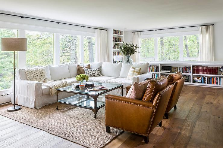 white slipcovered sectional with industrial coffee tabe