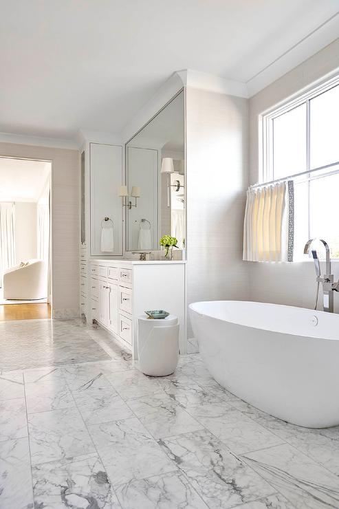 Egg Shaped Bathtub on Gray and White Marble Floor