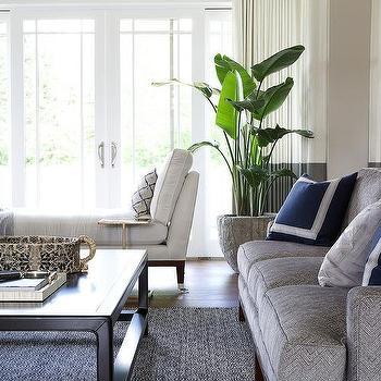 Dark Gray Herringbone Sofa With Royal Blue Velvet Pillows