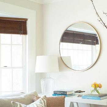 Round Gold Mirror Over White Trestle Console Table
