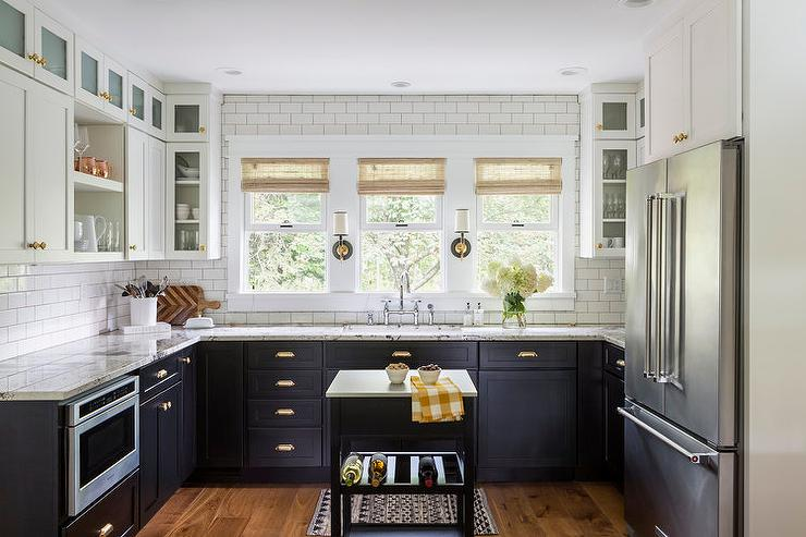 kitchen white upper cabinets dark lower black lower cabinets with brass cup pulls transitional 22186