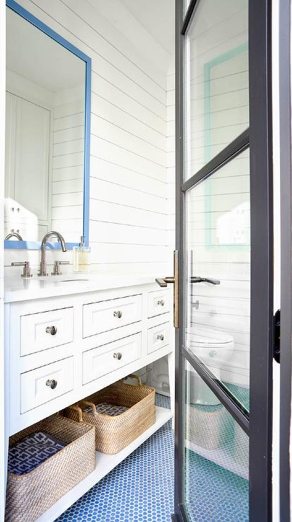 White And Blue Bathroom With Mirror